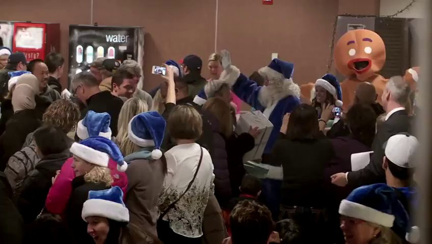 Santaclaus giving gifts at Airport Arrival !! WestJet Christmas Miracle